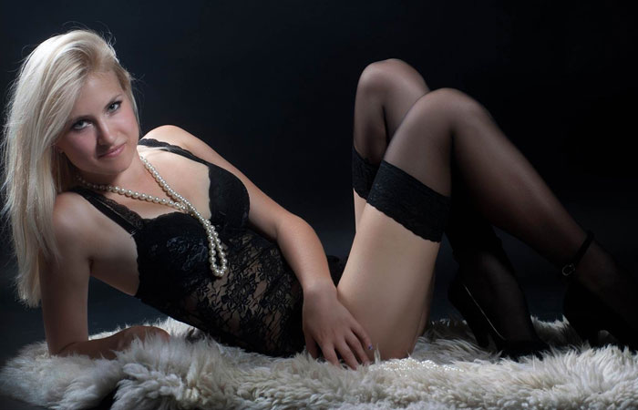 blonde Ukrainian girl in a black lingerie