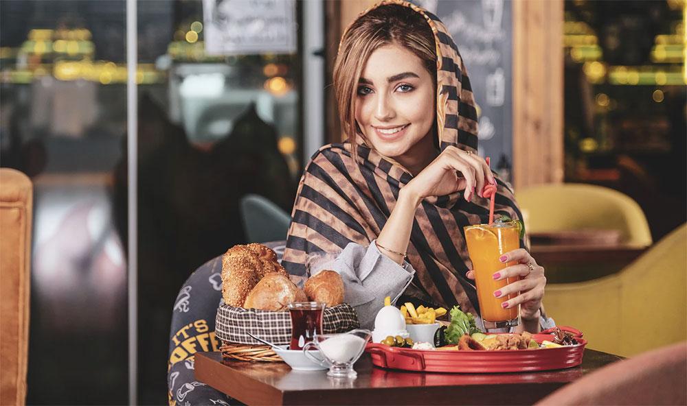 beautiful Ukrainian lady drinking juice