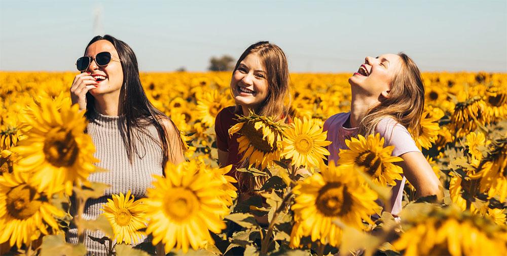 happy Ukrainian girls in sunflower field